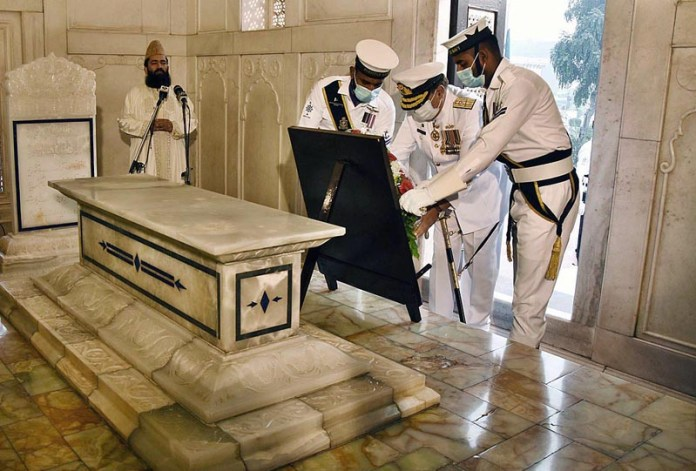 LAHORE: November 09 - Pakistan Navy Station Commander Commodore Nematullah laying floral wreath during change of guard ceremony to pay homage to the Poet of the East Allama Muhammad Iqbal on his 143rd birthday anniversary at Mazar-e-Iqbal. APP Photo by Mustafa Lashari