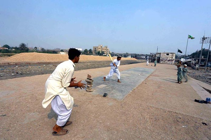 Youngsters playing cricket near Railway Station