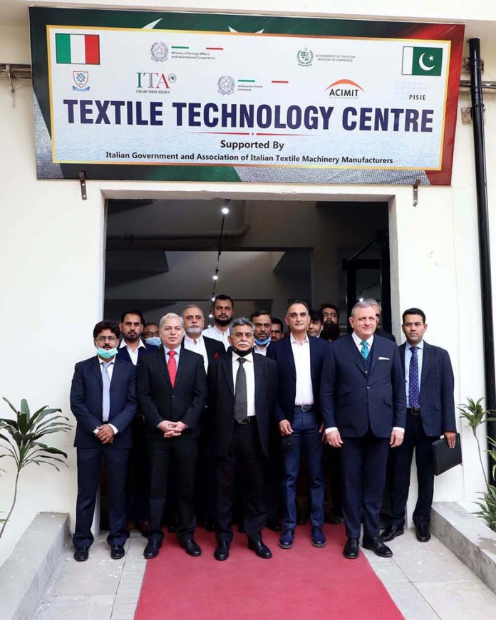 A group photograph of participants with Italian Envoy Andreas Ferrarse after inauguration of Italy-Pakistan Textile Technology Center (IPTTC) established at National Textile University Faisalabad (NTUF)