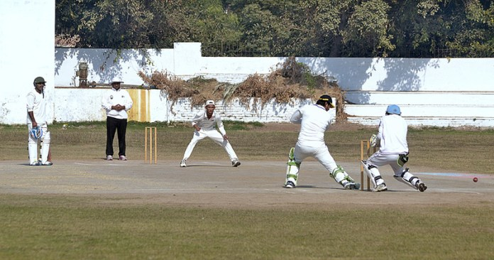 Players in action during final cricket match played between United Cricket Club Kot Addu and Maan Cricket Club Multan during Rashid Minhas Memorial Cricket Tournament at MCG