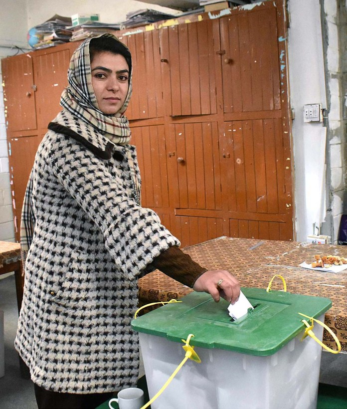 A woman cast her vote at polling station GBA-03 Sultan Abad during Gilgit-Baltistan Election 2020