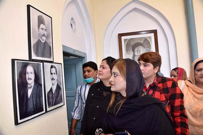 SIALKOT: November 09 – Visitors keenly viewing portraits of Dr. Allama Muhammad Iqbal while visiting Iqbal Manzal on the occasion of birth anniversary of Allama Iqbal. APP photo by Muhammad Munir Butt