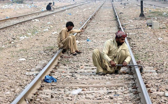 Railway staffers busy in maintenance work of railway tracks near Cantt Station