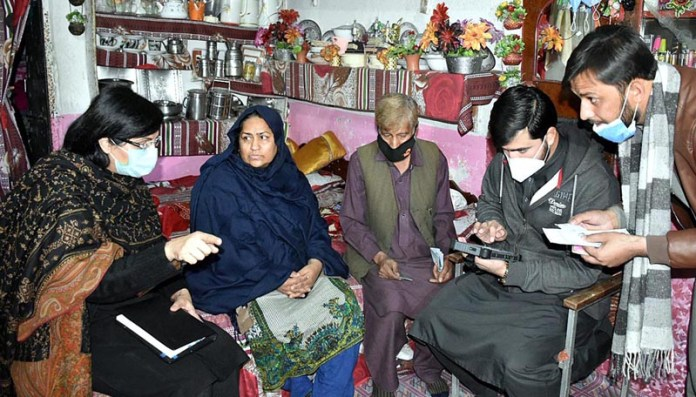 Special Assistant to the Prime Minister on Poverty Alleviation and Social Safety, Dr. Sania Nishtar talking to a beneficiary of national socio-economic survey under Ehsaas Program in Sikander Town
