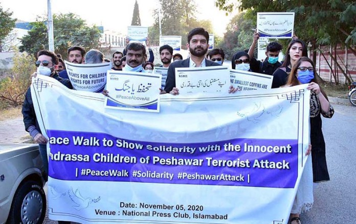 ISLAMABAD: November 05 – People from different walks of life participating in a peace walk to show solidarity with Peshawar terrorist attack on madrassa organised by SSDO in front of National Press Club. APP photo by Irshad Sheikh