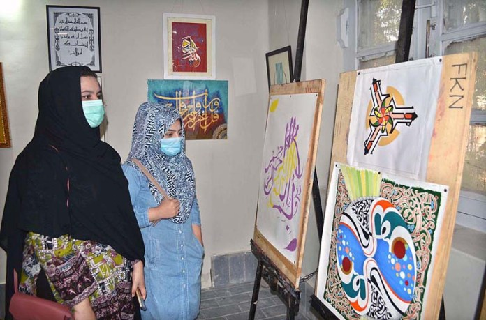 November 19 – Students viewing art work during calligraphy exhibition in connection with celebration of Shan-e-Rehmatul-Lil-Alameen Week at Sargodha University