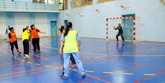 view of handball match being played between the Women's University and Bahawalpur teams