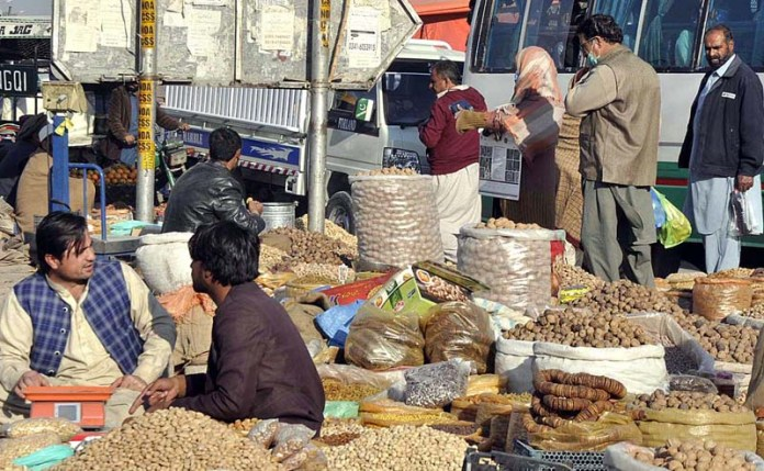 Vendors displaying different kind of dry fruits to attract the customers at their roadside setup
