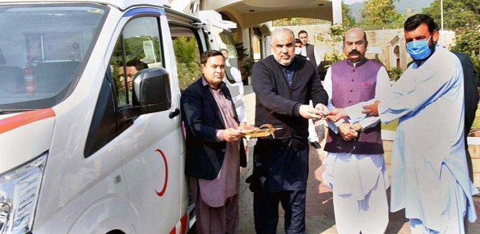 Speaker National Assembly Asad Qaiser handing over keys of ambulance as donation to the management of Bacha Khan Medical Complex, Swabi