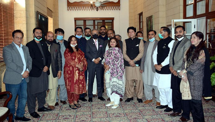 A group photograph of delegation of Insaf Welfare Wing Karachi Region with President Dr. Arif Alvi at Governor House