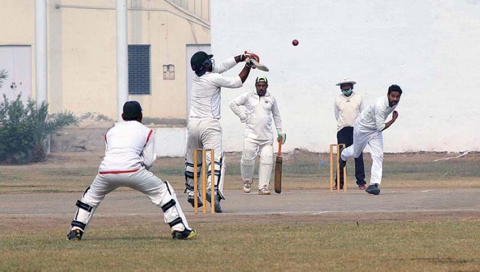 MULTAN: November 15 - Players in action during cricket match played between Crescent Club and Shuja Club at MCG. APP photo by Tanveer Bukhari