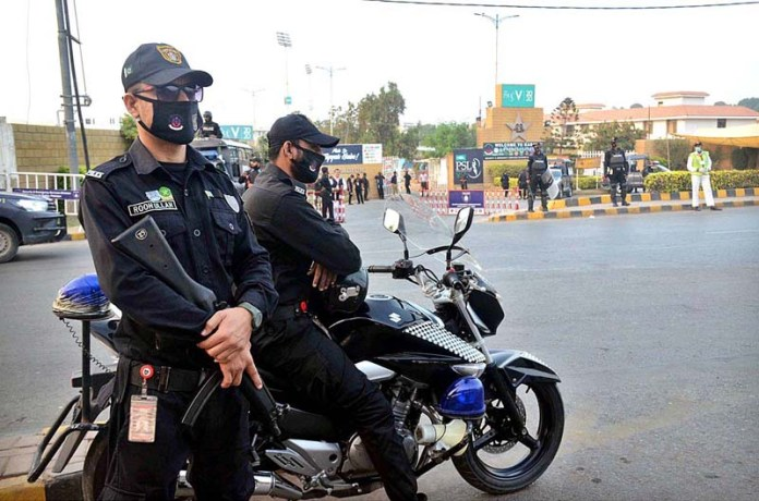 Security official high alert at the National Stadium during the Pakistan Super League (PSL) Twenty20 final cricket match between the Karachi Kings and Lahore Qalandars