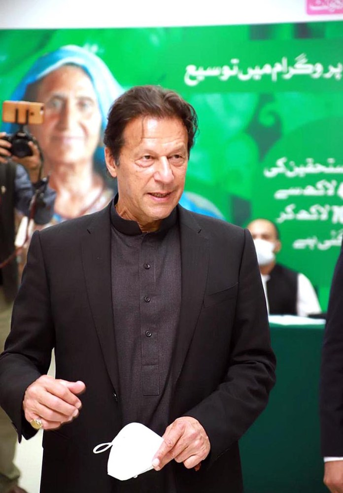 Prime Minister Imran Khan visiting the Ehsaas Kafaalat Payment site to kick off payments to 7 million beneficiaries