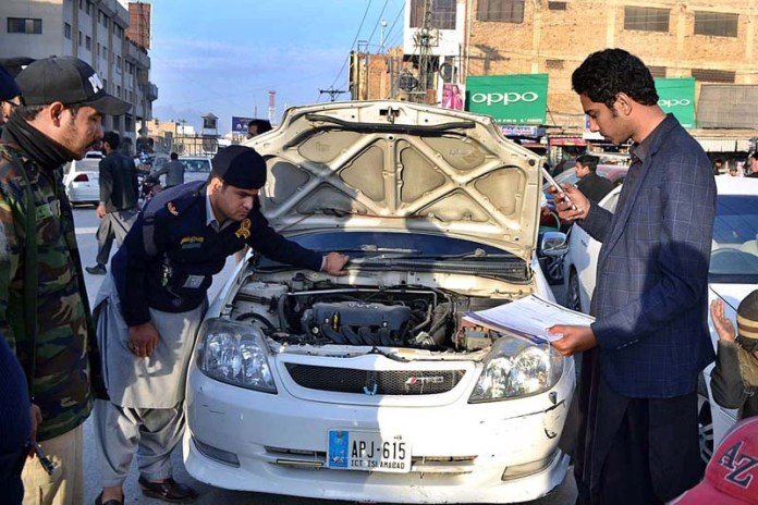 Custom officials and police personnel checking non-custom paid vehicles at Meezan Chowk