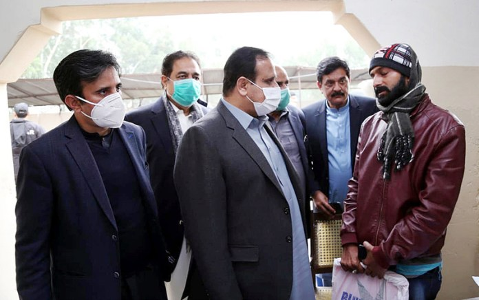 Punjab Chief Minister Sardar Usman Buzdar talking to a complainant during his surprise visit to Airport Police Station