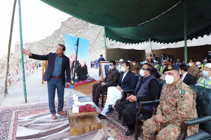 CHILAS: November 01 - Chairman WAPDA briefs Prime Minister Imran Khan on progress of work at Diamer Bhasha Dam site. APP