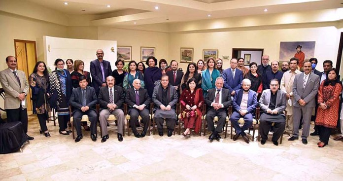 Senator Shibli Faraz Federal Minister for Information and Broadcasting in a group photo with information group officers during a reception