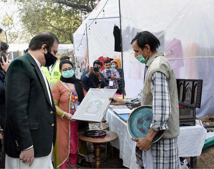 Senator Shibli Faraz, Federal Minister for Information and Broadcasting visiting stalls in Lok Mela being held at Lok Virsa