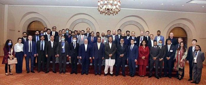 A group photo of members of technical committees from Russia and Pakistan on Pakistan Stream Gas Pipeline (PSGP) project with Federal Minister for Energy Omar Ayub Khan and Special Assistant to Prime Minister on Petroleum Nadeem Babar