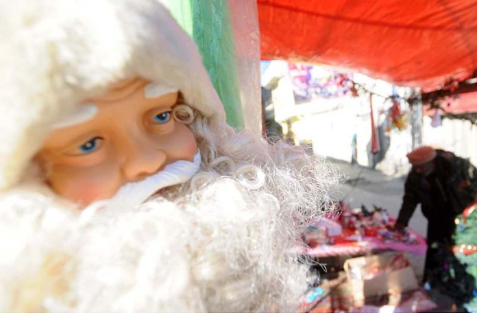 A vendor displaying Christmas related items to attract the customers in connection with upcoming Christmas celebrations