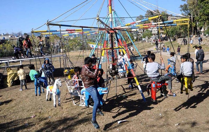 Christian children enjoying swing in Federal Capital