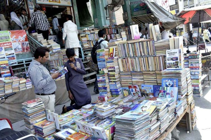 People busy in purchasing books from a stall in Aminpur Bazaar