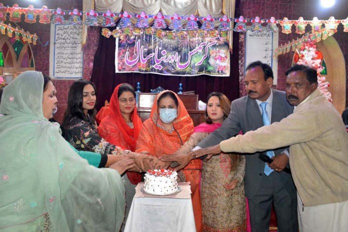 PTI Leader Dr. Nadia Aziz and Christian community cutting cake during function in connection with Christmas celebrations at U P Church Nori Gate