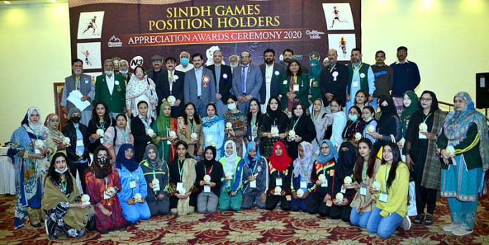 A group photograph of Sindh Games position holders with Additional IG Sindh Police Dr Jameel Ahmed during appreciation award ceremony 2020