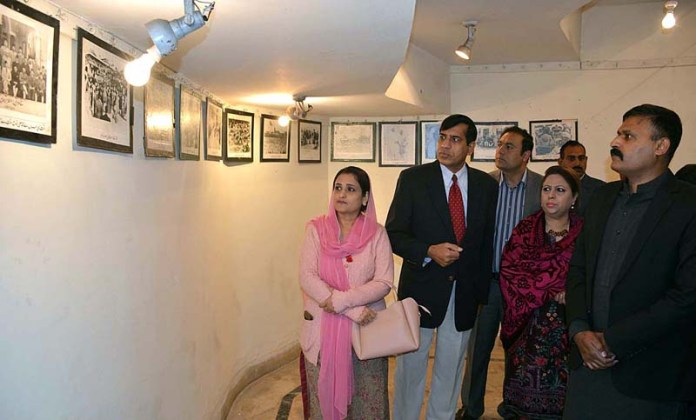 AC City Syed Ayub Bukhari, Resident Director Arts Council Zahid Iqbal and other viewing the displayed historical and rare photographs of Quaid-e-Azam Muhammad Ali Jinnah in an exhibition arranged by Arts Council in connection with Quaid-e-Azam birth anniversary