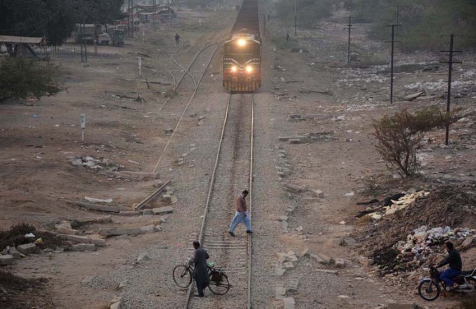People crossing Nishatabad railway tracks as train approaching on the same track may cause any mishap and needs the attention of concerned authorities