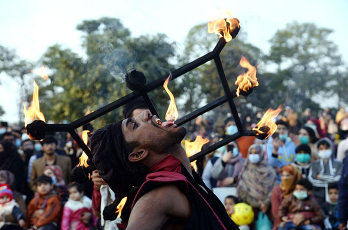A juggler demonstrating his skills during a festival at Race Course Jilani Park