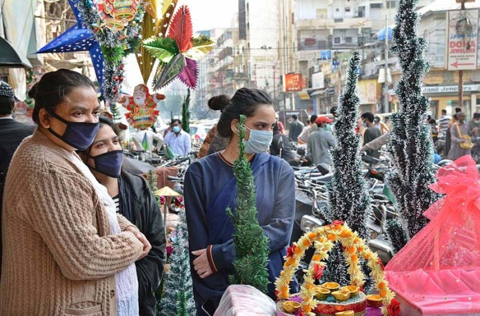 Women from Christian community purchasing different items from Bohri Bazaar for upcoming Christmas celebrations in Provincial Capital