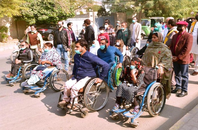 Disabled persons participating in a rally to mark World Disability Day organized by society for special persons at Nawan Sher