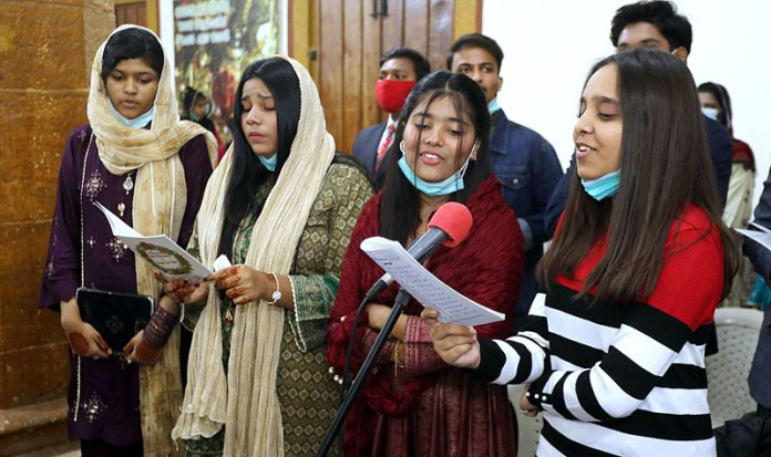 Christian singing carol during Christmas service at St. Thomas Church Civil Lines