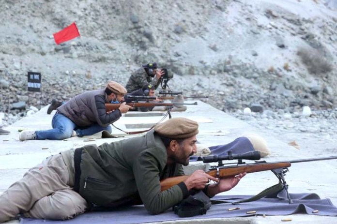 Participant in action during Gilgit-Baltistan Scouts organized Jashan-e-Azadi Gilgit-Baltistan Frist Firing Competition 2020