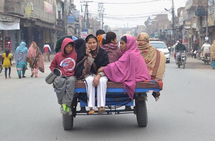 – Gypsy family members traveling on the tricycle rickshaw