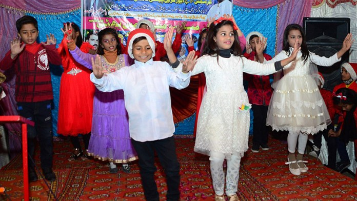 Children performing in a tableau during a function in connection with upcoming Christmas celebrations at Christian