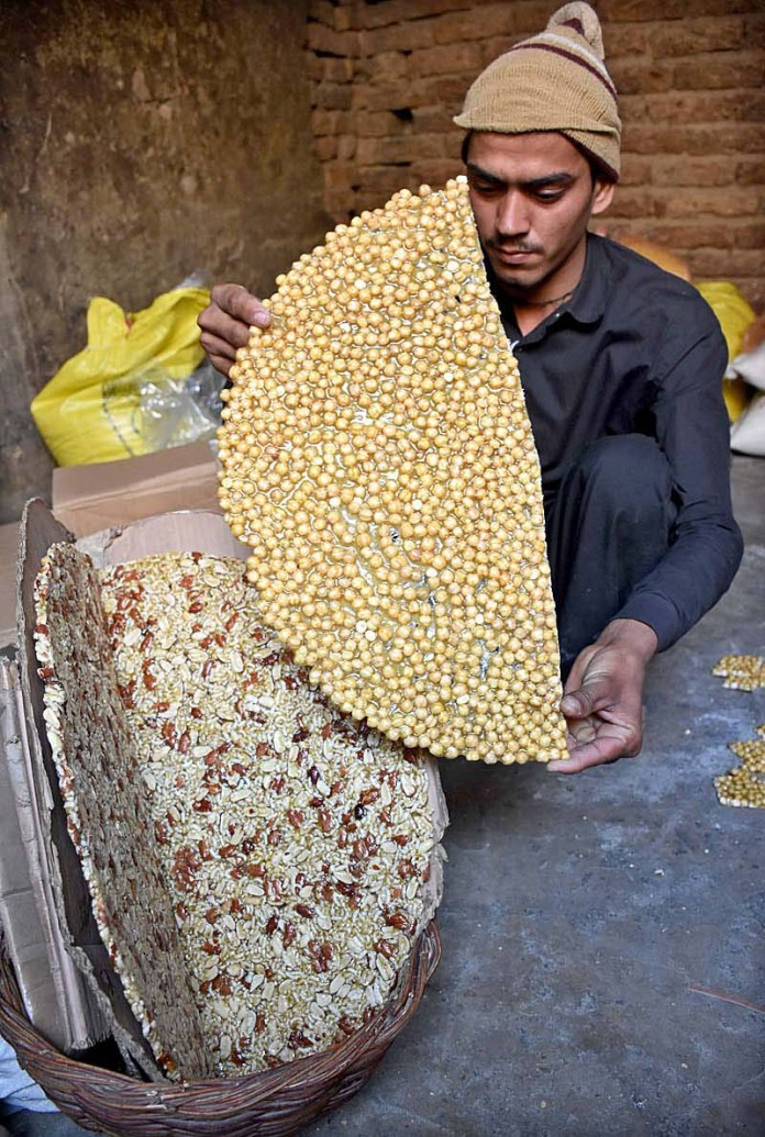 A vendor preparing traditional sweet items at Jalas Bazaar