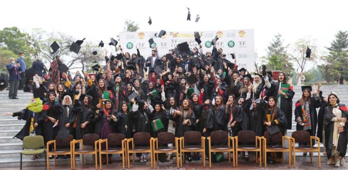 - Students throwing caps in the air in traditional way during 7th convocation of The University of Faisalabad