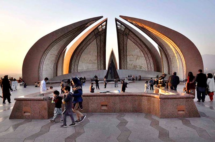 People visiting National Monument during evening time in Federal Capital