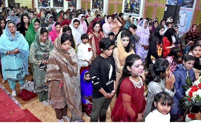 People from Christian community busy in religious rituals at St. Joseph's Catholic Church to mark Christmas celebrations