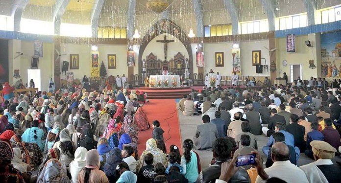 A large number of people from Christian community attending religious rituals at Catholic Church to mark the Christmas celebrations at Railway Road