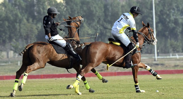 Players struggling to get hold on the ball during Maj Gen Saeed-uz-Zaman Janjua Memorial Polo Cup 2020 played between Master Paints and AOS. Master Paints won by 11-7 at Jinnah Polo & Country Club