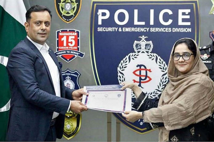 DIG Security and Emergency Services Division Maqsood Ahmed giving away certificate to officer of civil servants during Self-Defence and Firearms Safety Course conducted at SSU Headquarters