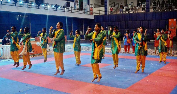 Students performing in tableau during Deputy Commissioner Lahore Games at Nishtar Sports Complex