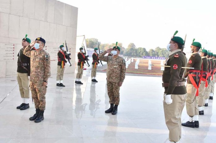 Pak Army soldiers presenting guard of honor at APS Martyrs Memorial