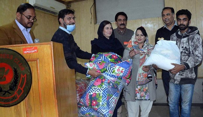 Ration being distributed among the employees of Press Club on the occasion of Christmas organized by Kiran Welfare Foundation