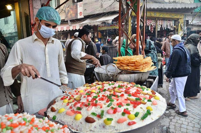 A vendor displaying traditional sweet (Gajjar Halwa) to attract the customers at his shop