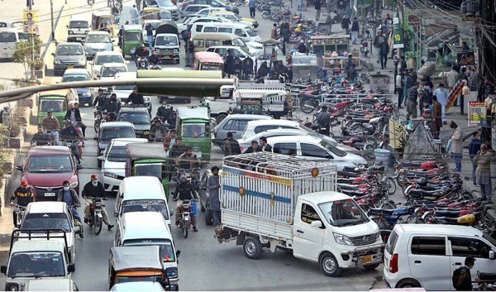 """A view of vehicles and motoryclces parked at """"No Parking"""" area of 6th Road causing hurdles in the smooth flow of traffic and needs the attention of the concerned authorities"""