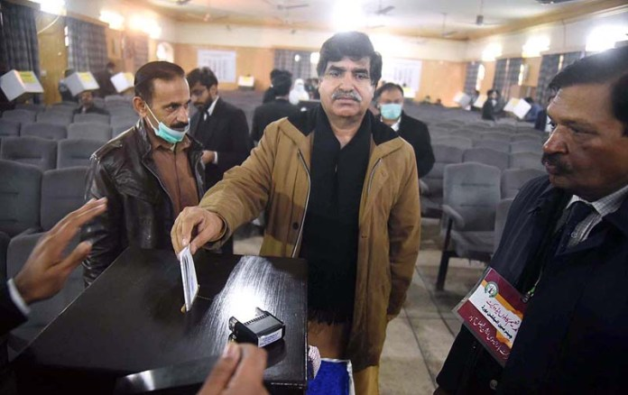 A lawyer casting his vote during annual elections of District Bar Association (DBA)